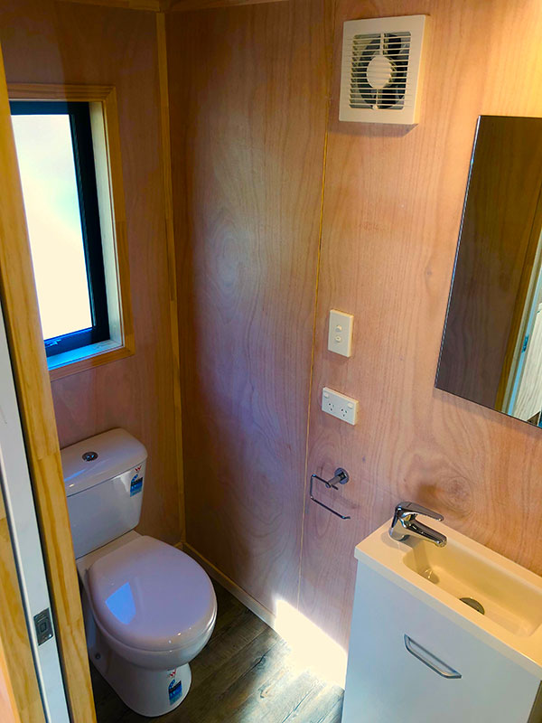 Bathroom in Tiny Home showing toilet and vanity sink