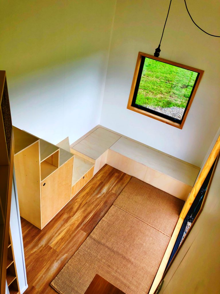 Tiny Home Storage Stairs and Couch Area